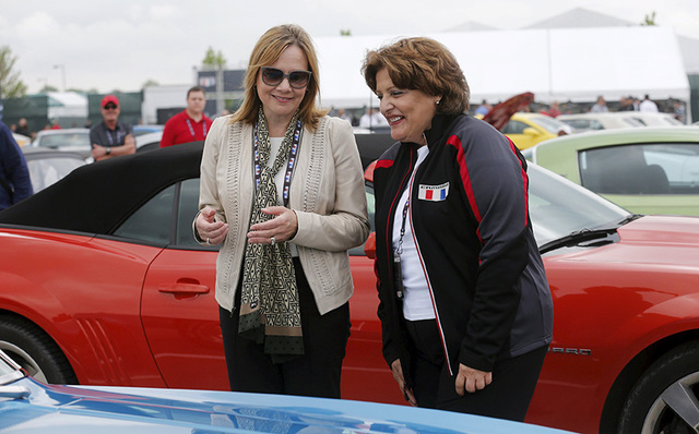 General Motors Co's Chief Executive Officer Mary Barra (L) greets Camaro owners before the official debut of the all-new Chevrolet 2016 Camaro SIX at Belle Isle in Detroit, Michigan May 16, 2015.  ...