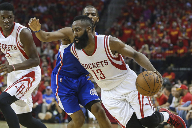 May 17, 2015; Houston, TX, USA; Houston Rockets guard James Harden (13) drives the ball around Los Angeles Clippers guard Chris Paul (3) during the second quarter in game seven of the second round ...