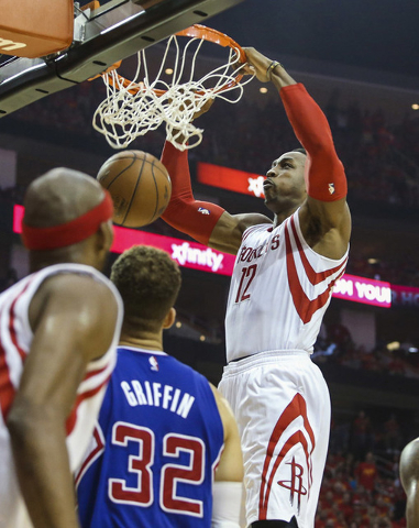 May 17, 2015; Houston, TX, USA; Houston Rockets center Dwight Howard (12) dunks the ball during the second quarter against the Los Angeles Clippers in game seven of the second round of the NBA Pla ...