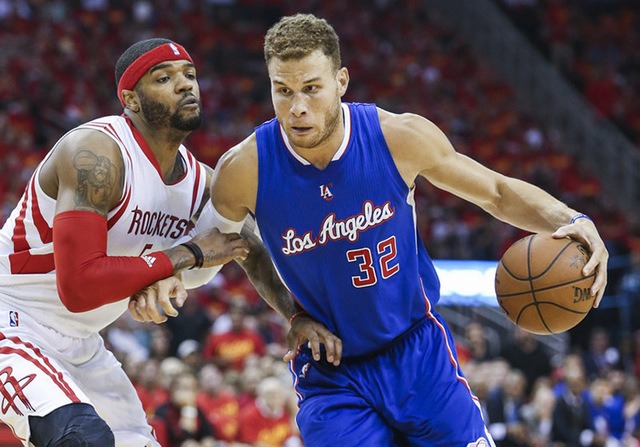 May 17, 2015; Houston, TX, USA; Los Angeles Clippers forward Blake Griffin (32) drives the ball during the third quarter as Houston Rockets forward Josh Smith (5) defends in game seven of the seco ...
