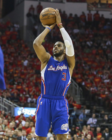 May 17, 2015; Houston, TX, USA; Los Angeles Clippers guard Chris Paul (3) shoots the ball during the third quarter against the Houston Rockets in game seven of the second round of the NBA Playoffs ...