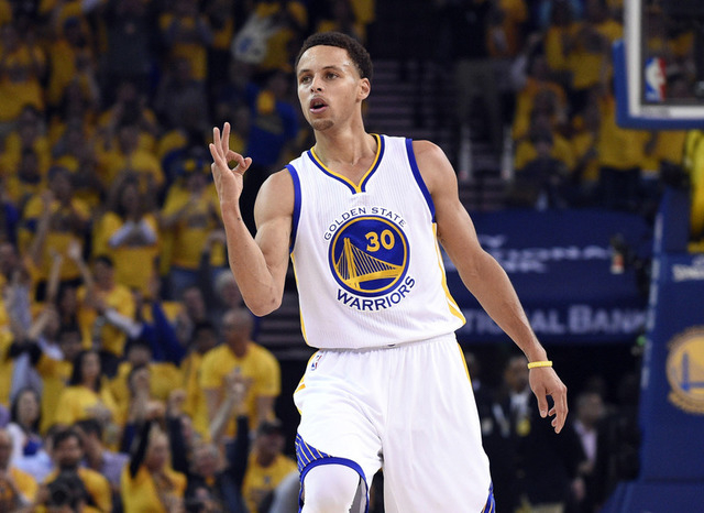 May 19, 2015; Oakland, CA, USA; Golden State Warriors guard Stephen Curry (30) reacts after making a three point basket against the Houston Rockets in the first quarter in game one of the Western  ...