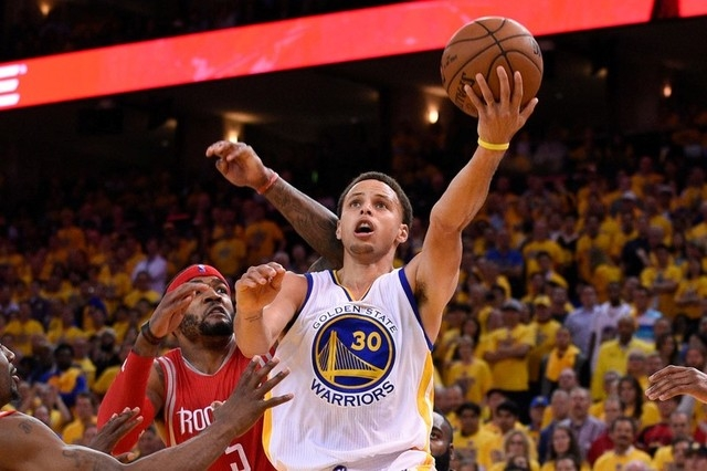 Golden State Warriors guard Stephen Curry (30) shoots a layup against Houston Rockets forward Josh Smith (5) during the fourth quarter in game one of the Western Conference Finals of the NBA Playo ...