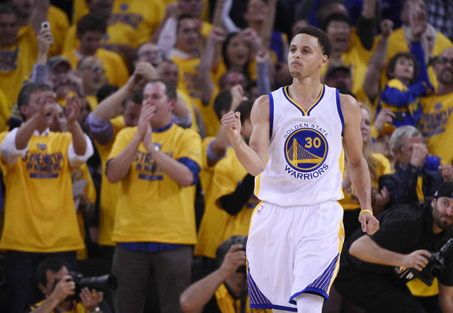 May 19, 2015; Oakland, CA, USA; Golden State Warriors guard Stephen Curry (30) pumps his fist in the second half in game one of the Western Conference Finals of the NBA Playoffs against the Housto ...