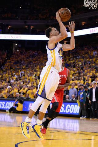 May 19, 2015; Oakland, CA, USA; Golden State Warriors guard Stephen Curry (30) shoots the basketball against the Houston Rockets during the fourth quarter in game one of the Western Conference Fin ...