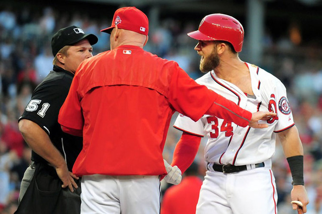 May 20, 2015; Washington, DC, USA; Washington Nationals outfielder Bryce Harper (right) and manager Matt Williams (center) react after being thrown out of the game by home plate umpire Marvin Huds ...