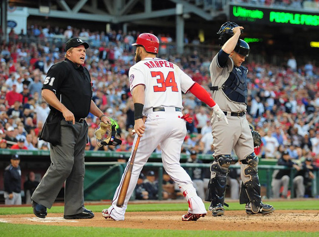 May 20, 2015; Washington, DC, USA; Washington Nationals outfielder Bryce Harper (34) reacts after being thrown out of the game by home plate umpire Marvin Hudson (left) in the third inning against ...