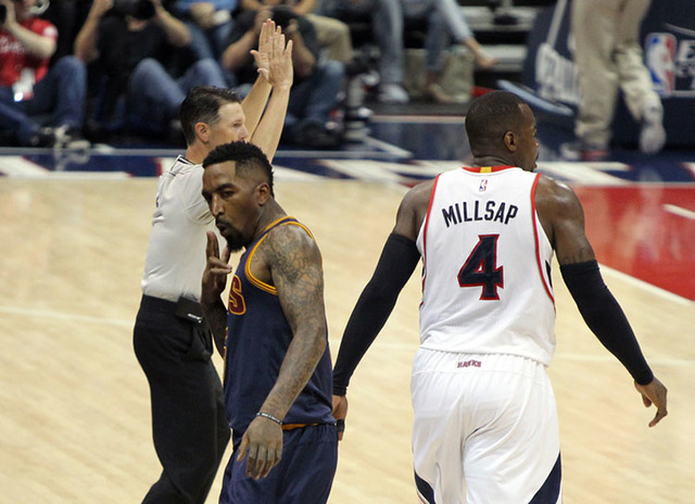 May 20, 2015; Atlanta, GA, USA; Cleveland Cavaliers guard J.R. Smith (5) reacts after making a basket against Atlanta Hawks forward Paul Millsap (4) during the fourth quarter of game one of the Ea ...