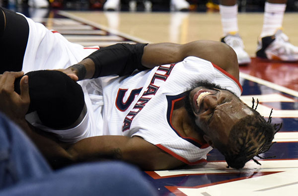 May 20, 2015; Atlanta, GA, USA; Atlanta Hawks forward DeMarre Carroll (5) reacts after an apparent injury during the fourth quarter of game one of the Eastern Conference Finals of the NBA Playoffs ...