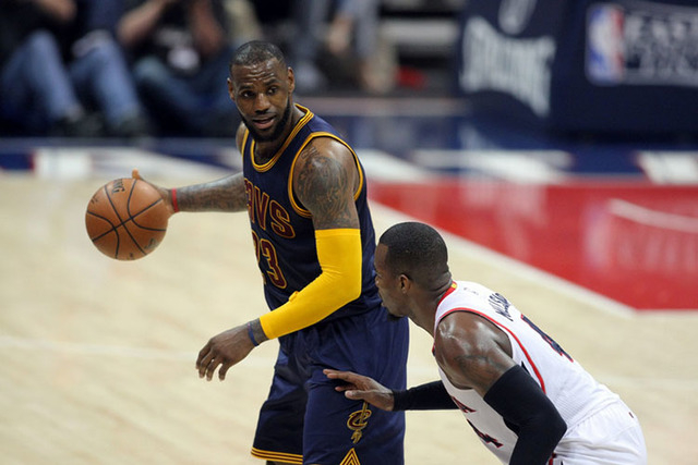 May 20, 2015; Atlanta, GA, USA; Cleveland Cavaliers forward LeBron James (23) controls the ball against Atlanta Hawks forward Paul Millsap (4) during the fourth quarter of game one of the Eastern  ...