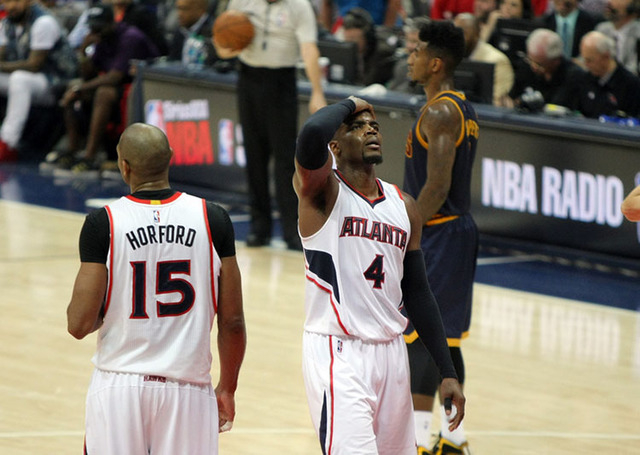 May 20, 2015; Atlanta, GA, USA; Atlanta Hawks forward Paul Millsap (4) reacts during the fourth quarter of game one of the Eastern Conference Finals of the NBA Playoffs Cleveland Cavaliers forward ...