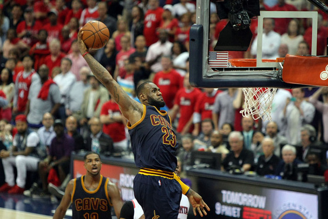 May 20, 2015; Atlanta, GA, USA; Cleveland Cavaliers forward LeBron James (23) dunks against the Atlanta Hawks during the fourth quarter of game one of the Eastern Conference Finals of the NBA Play ...
