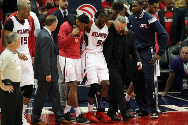 May 20, 2015; Atlanta, GA, USA; Atlanta Hawks forward DeMarre Carroll (5) is helped off the court after an apparent injury during the fourth quarter of game one of the Eastern Conference Finals of ...