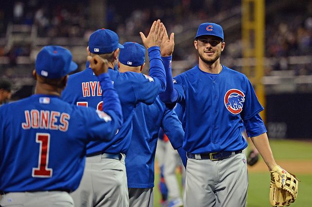Chicago Cubs third baseman Kris Bryant, right, high-fives teammates after the Cubs beat the San Diego Padres 3-0 at Petco Park in San Diego, May 21, 2015. (Jake Roth-USA TODAY Sports)