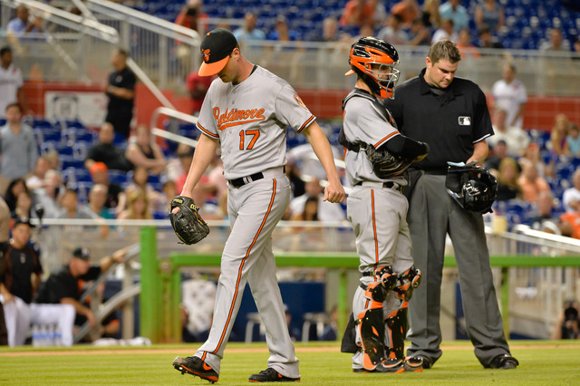 May 23, 2015; Miami, FL, USA; Baltimore Orioles relief pitcher Brian Matusz (17) leaves the game after some for foreign substance was found on his arm during the 12th inning against the Miami Marl ...