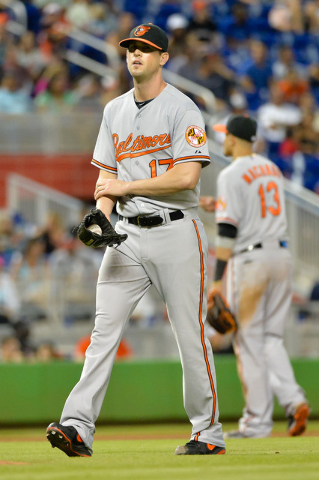 May 24, 2015; Miami, FL, USA; Baltimore Orioles relief pitcher Brian Matusz (17) circles the pitchers mound during the eighth inning against the Miami Marlins at Marlins Park. The Marlins won 5-2. ...