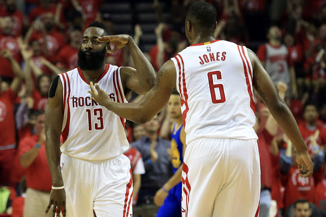 May 25, 2015; Houston, TX, USA; Houston Rockets guard James Harden (13) celebrates with forward Terrence Jones (6) against the Golden State Warriors during the first quarter in game four of the We ...