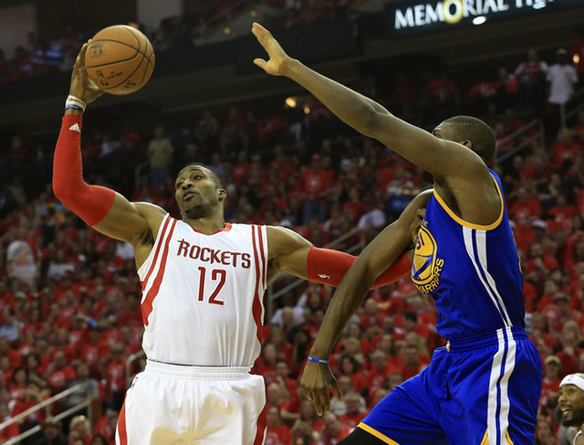May 25, 2015; Houston, TX, USA; Houston Rockets center Dwight Howard (12) grabs the ball away from Golden State Warriors center Festus Ezeli (31) during the first quarter in game four of the Weste ...