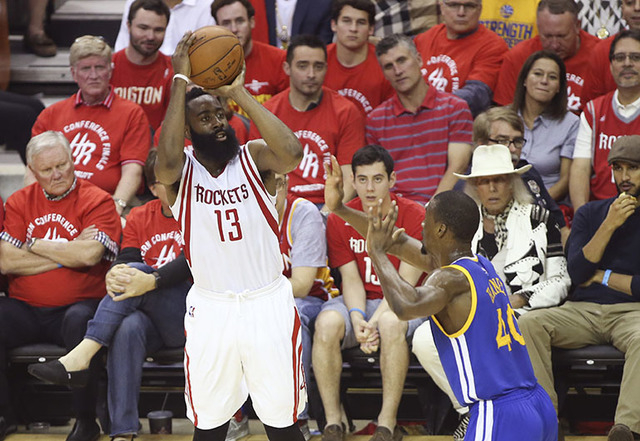 May 25, 2015; Houston, TX, USA; Houston Rockets guard James Harden (13) shoots past Golden State Warriors forward Harrison Barnes (40) during the second half in game four of the Western Conference ...