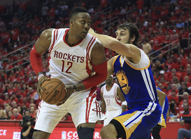May 25, 2015; Houston, TX, USA; Houston Rockets center Dwight Howard (12) looks to score as Golden State Warriors center Andrew Bogut (12) defends during the second half in game four of the Wester ...