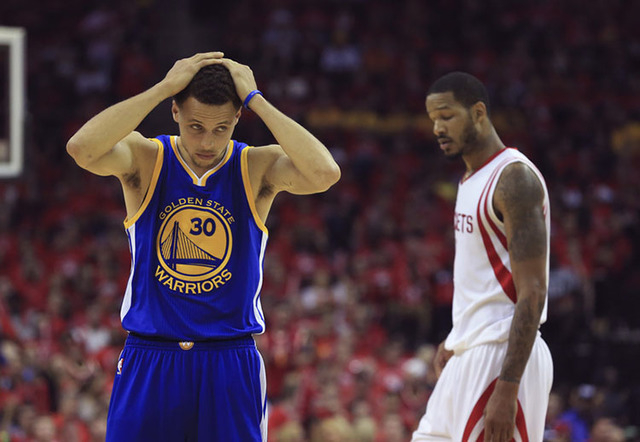 May 25, 2015; Houston, TX, USA; Golden State Warriors guard Stephen Curry (30) reacts during the second half against the Houston Rockets in game four of the Western Conference Finals of the NBA Pl ...