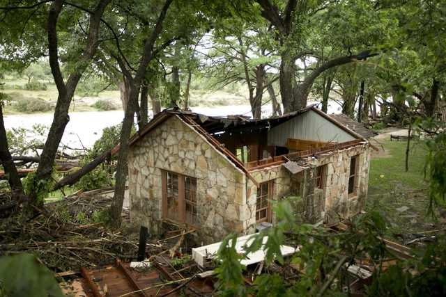 A cabin is destroyed on the banks of the Blanco River after flooding in Wimberley, Texas, United States May 24, 2015. (REUTERS/Jay Janner/American-Statesman)