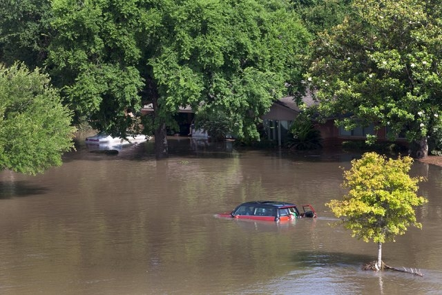 Cars and houses are seen covered by floodwaters in southwest Houston, Texas May 26, 2015. Torrential rains have killed at least eight people in Texas and Oklahoma, including two in Houston where f ...