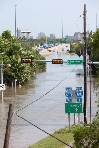 Flood waters cover the intersection of Braeswood Blvd and the I-610 frontage road in Houston, Texas May 26, 2015. Torrential rains have killed at least eight people in Texas and Oklahoma, includin ...