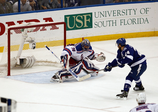 May 26, 2015; Tampa, FL, USA; Tampa Bay Lightning right wing Ryan Callahan (24) scores on New York Rangers goalie Henrik Lundqvist (30) during the first period of game six of the Eastern Conferenc ...