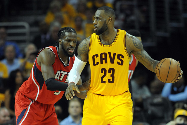 May 26, 2015; Cleveland, OH, USA; Cleveland Cavaliers forward LeBron James (23) handles the ball against Atlanta Hawks forward DeMarre Carroll (5) during the third quarter in game four of the East ...