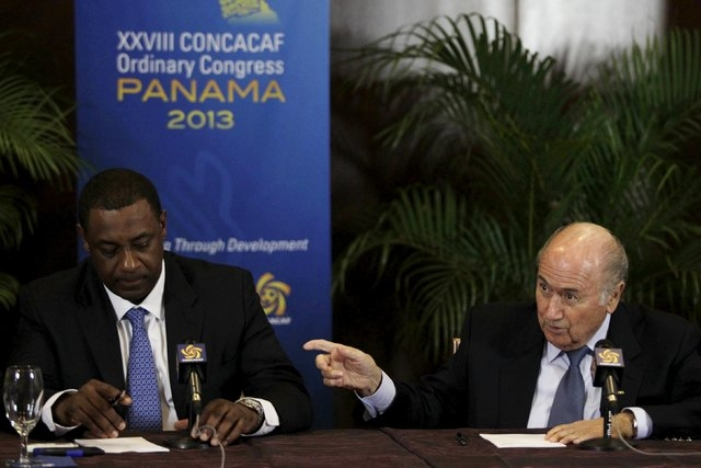 """FIFA President Joseph """"Sepp"""" Blatter, right, gestures next to CONCACAF President Jeffrey Webb during a news conference at the CONCACAF congress in Panama City, April 19, 2013. The world's most pop ..."""