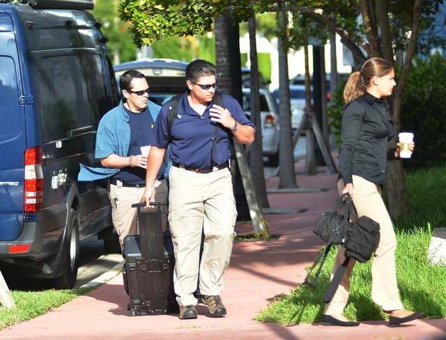 FBI agents prepare to enter the offices of CONCACAF, the soccer federation that governs North America, Central America and the Caribbean, in Miami Beach, Florida, May 27, 2015. Seven of the most p ...
