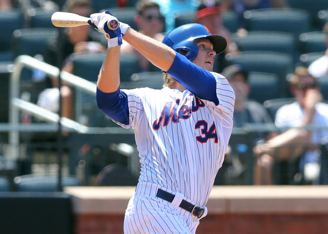 May 27, 2015; New York City, NY, USA; New York Mets starting pitcher Noah Syndergaard (34) hits a solo home run against the Philadelphia Phillies during the fourth inning at Citi Field. (Brad Penn ...