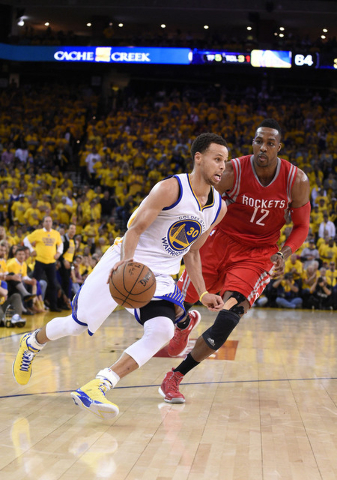 May 27, 2015; Oakland, CA, USA; Golden State Warriors guard Stephen Curry (30) dribbles past Houston Rockets center Dwight Howard (12) during the third quarter in game five of the Western Conferen ...