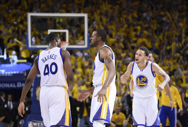May 27, 2015; Oakland, CA, USA; Golden State Warriors forward Harrison Barnes (40) and guard Andre Iguodala (middle) and guard Stephen Curry (30) react during the fourth quarter against the Housto ...