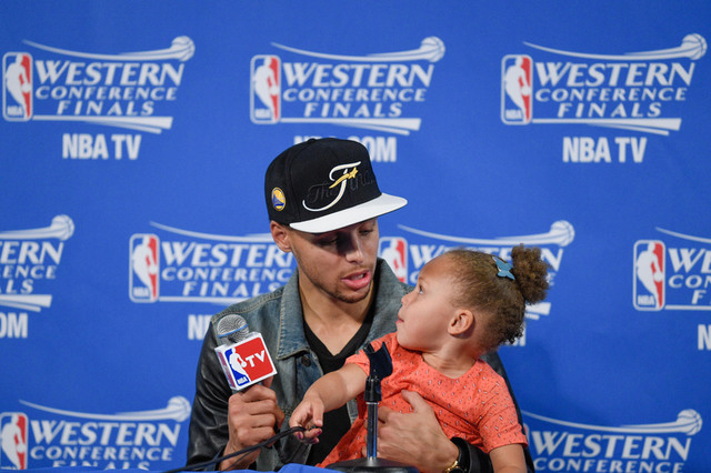 May 27, 2015; Oakland, CA, USA; Golden State Warriors guard Stephen Curry (30) and Riley Curry address the media in a press conference after game five of the Western Conference Finals of the NBA P ...