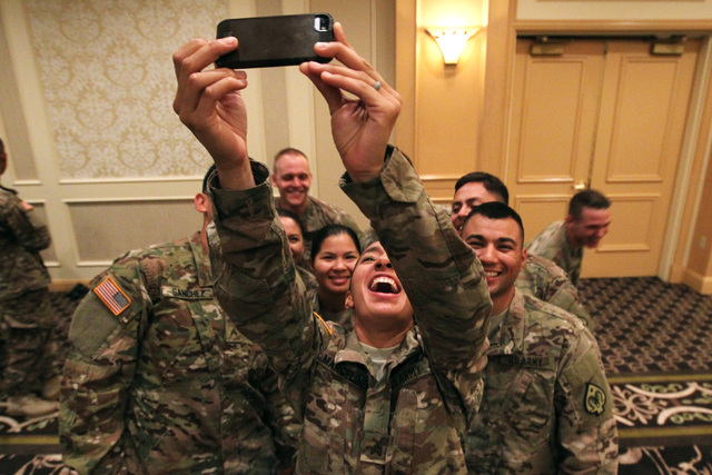 """Sgt. Eunice Marcelino takes a """"funny face"""" group photo with fellow members of the Nevada Army National Guard's 72nd Military Police Company after a deployment ceremony Thursday, May 28,  ..."""
