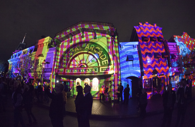 """Media and guests gather on Main Street, U.S.A. at Disneyland park on Wednesday, January 28, to view a demonstration of new projection technology planned for """"Disneyland Forever,"""" a new fireworks d ..."""