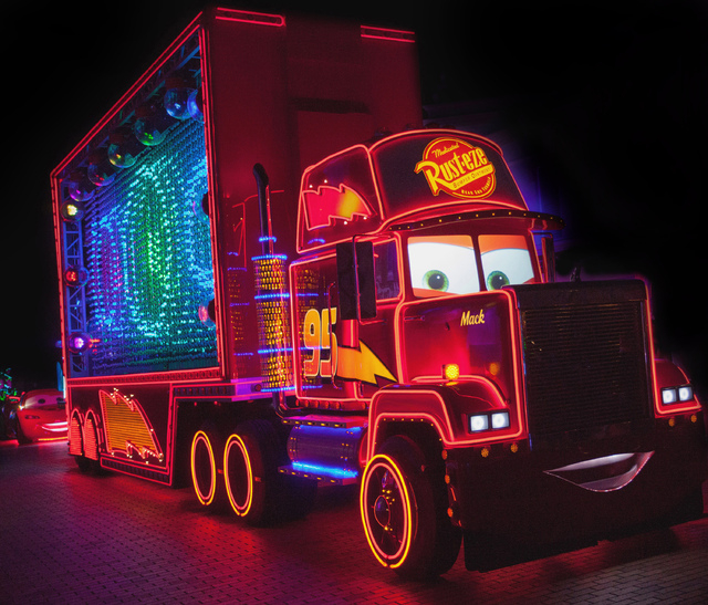 """Mack from the Disney/Pixar """"Cars"""" films is one of the characters featured in the new after-dark show, """"Paint the Night,"""" at Disneyland park, inspired by the iconic """"Main Street Electrical Parade."""""""