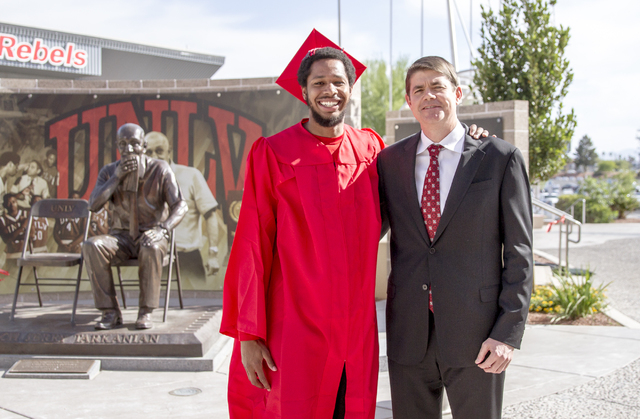 Former UNLV guard Jelan Kendrick, left, poses in his cap and gown with coach Dave Rice. Photo courtesy of UNLV.