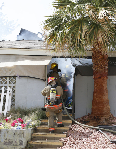 Clark County firefighters are battling an apartment complex fire on Haves St. near Interstate 15 and Pebble Road on Friday, May 8, 2015. At least 10 of 16 units in an apartment complex were affect ...
