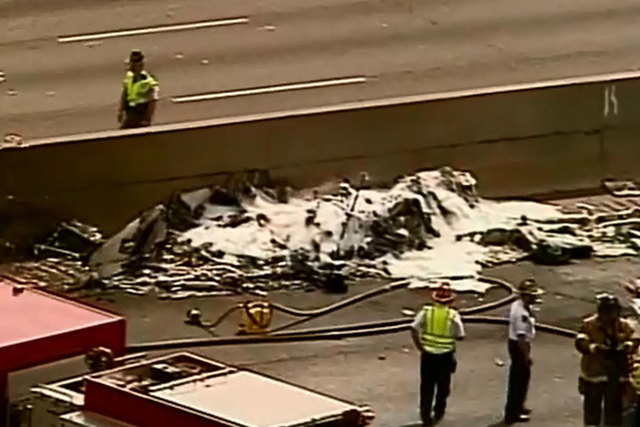 Four people died when their small plane crashed Friday morning, May 8, 2015, on a highway that encircles Atlanta. (Screengrab/Reuters)