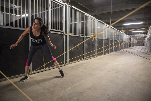A participant competes in the BADASS Dash obstacle course at the South Point hotel-casino in Las Vegas on Saturday, May 23, 2015. A portion of the proceeds will benefit non-profit organization Aut ...