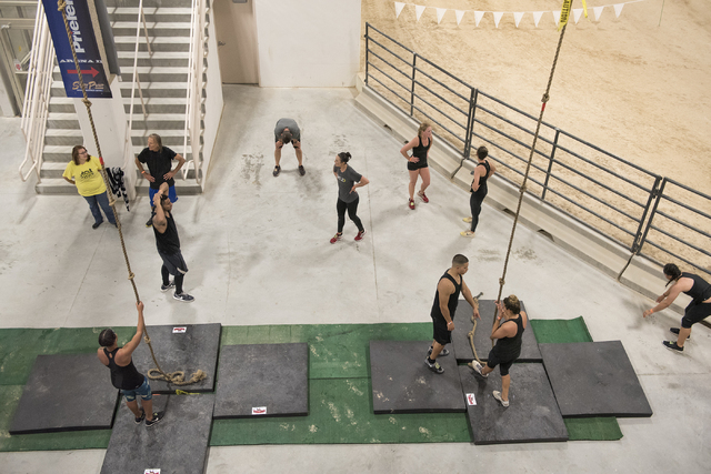 Participants compete in the BADASS Dash obstacle course at the South Point hotel-casino in Las Vegas on Saturday, May 23, 2015. A portion of the proceeds will benefit non-profit organization Autis ...