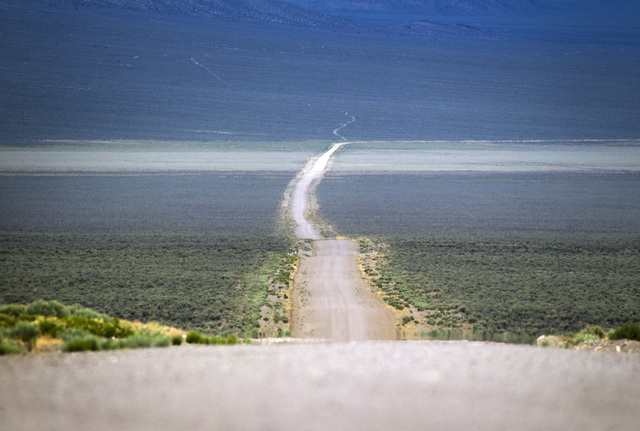A barren road is seen Wednesday, May 20, 2015, in Garden Valley, over a three-hour drive north of Las Vegas. Over 800,000 acres in central Nevada is proposed as the Basin and Range National Monume ...