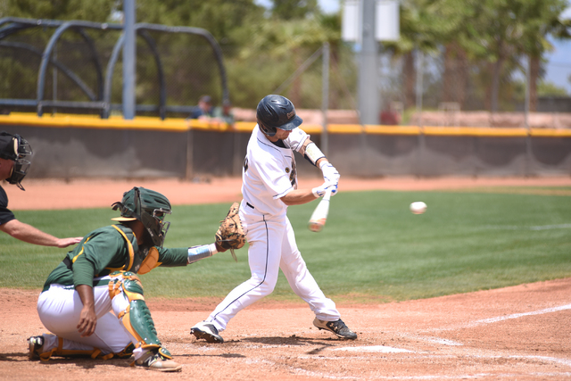 College of Southern Nevada's Matt Waldren (20) swings at a pitch against Yavapai College during their Western District Championship game played at Morse Stadium on the CSN campus in Henderson, Nev ...