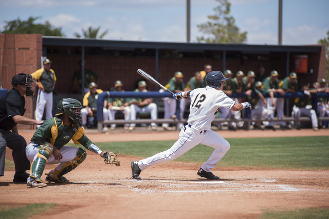 College of Southern Nevada's Kenny Meimerstorf (12) swings at a pitch against Yavapai College during their Western District Championship game played at Morse Stadium on the CSN campus in Henderson ...
