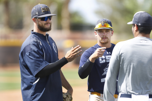 College of Southern Nevada's Alec Hutt, left, and Josh Nuernberg speak to each other during a baseball practice at Morse Stadium at the College of Southern Nevada Henderson Campus in Henderson, Ne ...