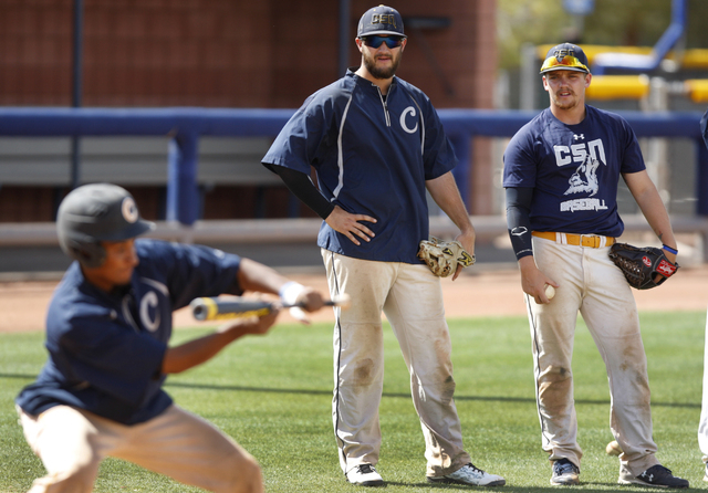 College of Southern Nevada's Alec Hutt, left, and Josh Nuernberg watch a teammate bunt the ball during a baseball practice at Morse Stadium at the College of Southern Nevada Henderson Campus in He ...