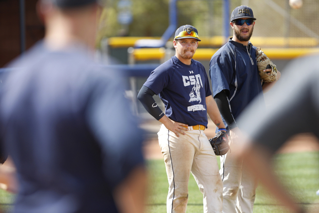 College of Southern Nevada's Alec Hutt, left, and Josh Nuernberg watch a teammate hit the ball during a baseball practice at Morse Stadium at the College of Southern Nevada Henderson Campus in Hen ...